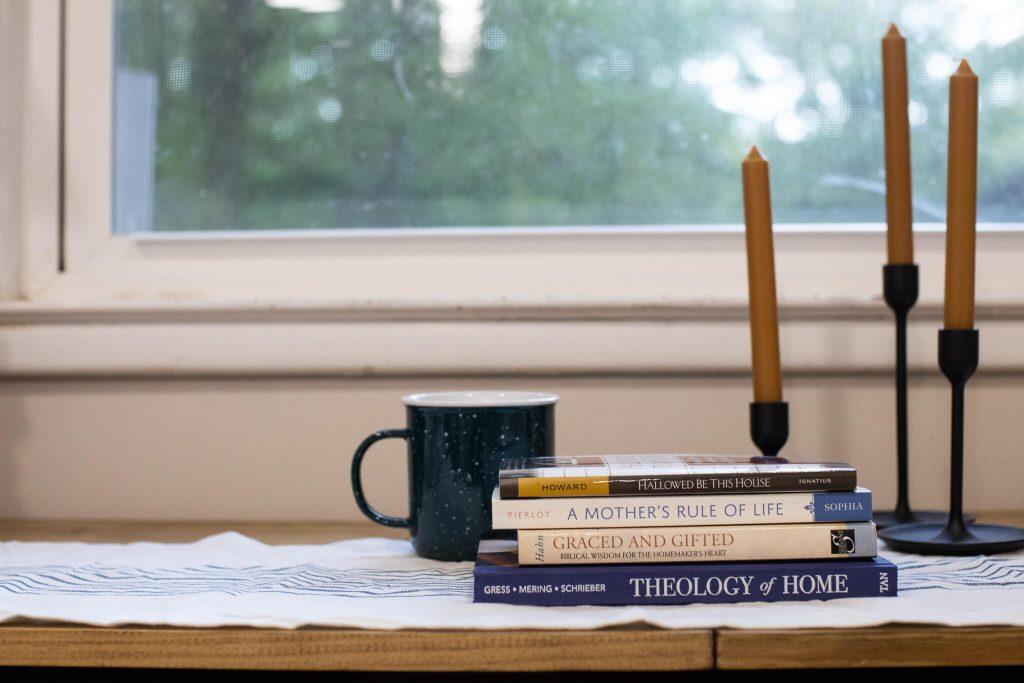 stack of catholic homemaking books
