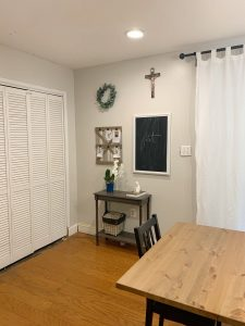 small table with chalkboard and cross