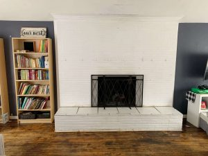 wide white painted brick fireplace