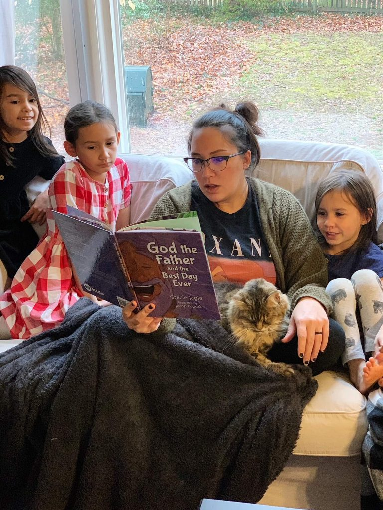 mom reading aloud God the Father and the Best Day Ever to children
