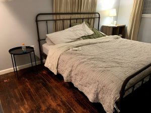 small bedroom with metal king bed