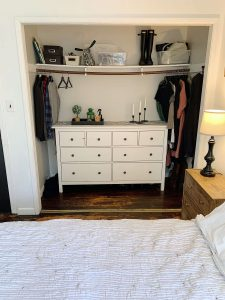small master closet with dresser in it