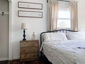 nightstand next to white bed