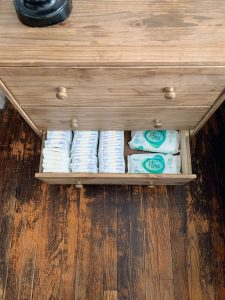 nightstand with diapers and wipes