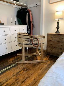 baby moses basket in master bedroom
